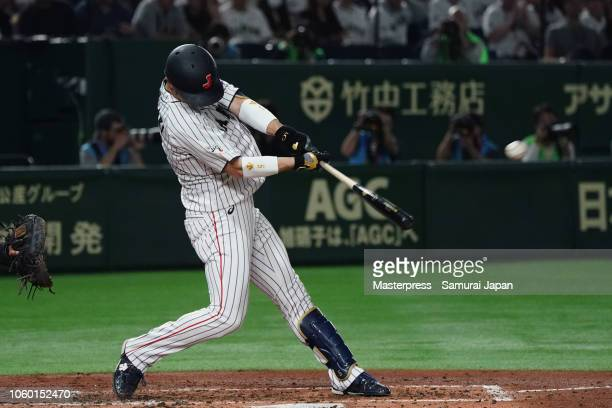 Infielder Shuta Tonosaki of Japan hits a RBI double to make it 11 in the bottom of 4th inning during the game three of Japan and MLB All Stars at...