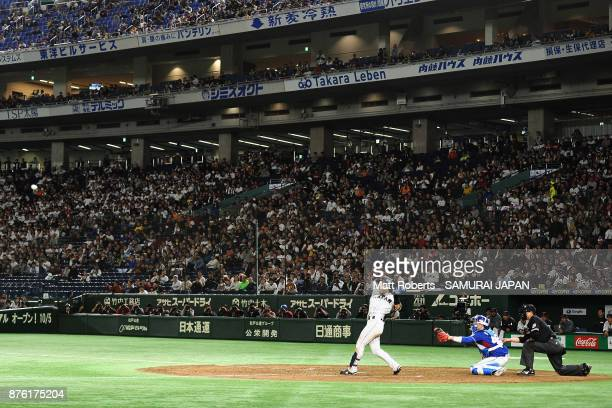 Infielder Shuta Tonosaki of Japan hits a RBI single to make it 20 in the bottom of fifth inning during the Eneos Asia Professional Baseball...