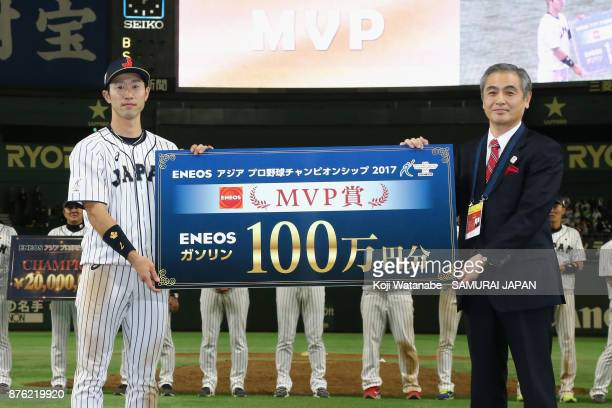 Infielder Shuta Tonosaki of Japan poses for photographs as he is awarded the most valuable player at the award ceremony after the Eneos Asia...
