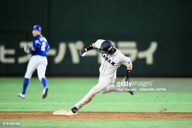 Infielder Shuta Tonosaki of Japan runs the second base to score a run in the bottom of fifth inning during the Eneos Asia Professional Baseball...