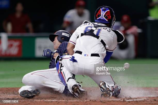 Infielder Shuta Tonosaki of Japan slides safely into the home to score a run by a tworun single by Infielder Tetsuto Yamada in the top of 7th inning...
