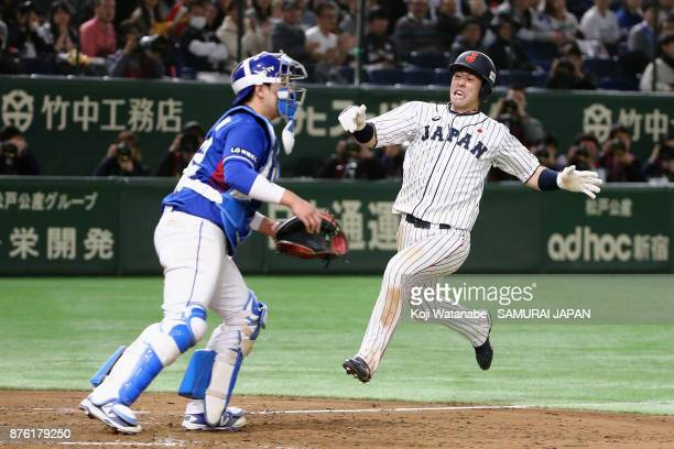 Infielder Shuta Tonosaki of Japan slides to the home plate to score a run to make it 40 after the two run double by Infielder Ryoma Nishikawa in the...