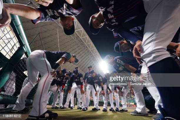 Infielder Shuta Tonozaki of Japan talks to his team mates in the huddle prior to the game between Samurai Japan and Canada at the Okinawa Cellular...