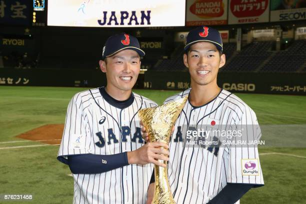 Infielder Sosuke Genda and Infielder Yota Kyoda of Japan pose with the trophy after the Eneos Asia Professional Baseball Championship 2017 final game...