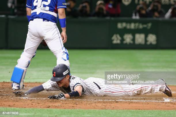 Infielder Sosuke Genda of Japan slides safely to score a run in the bottom of third inning during the Eneos Asia Professional Baseball Championship...