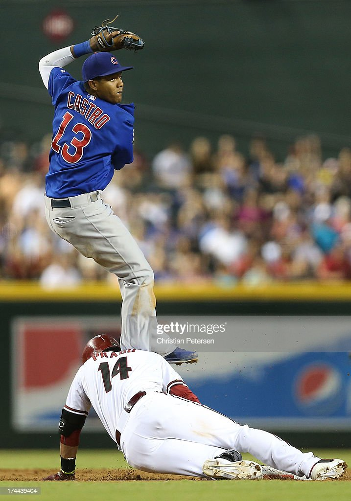 Infielder Starlin Castro #13 of the Chicago Cubs collides with Martin Prado #14 of the Arizona Diamondbacks as he slides into second base during the fifth inning of the MLB game at Chase Field on July 25, 2013 in Phoenix, Arizona.
