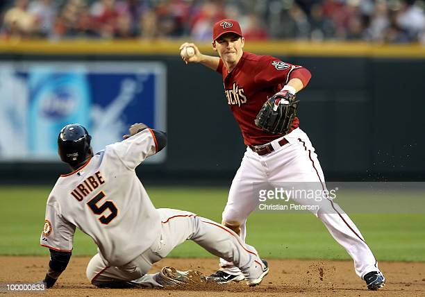 Infielder Stephen Drew of the Arizona Diamondbacks attempts a double over the sliding Juan Uribe of the San Francisco Giants during the second inning...