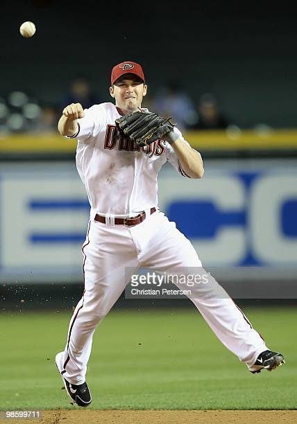 Infielder Stephen Drew of the Arizona Diamondbacks fields a ground ball out against the St Louis Cardinals during the Major League Baseball game at...
