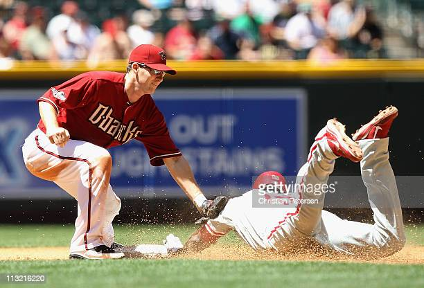 Infielder Stephen Drew of the Arizona Diamondbacks tags out John Mayberry of the Philadelphia Phillies as he attempts to steal second base during the...