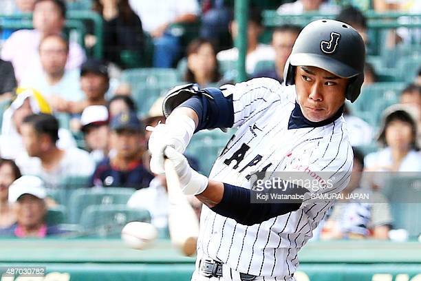 Infielder Taiga Hirasawa bats in the bottom half of the sixth inning in the super round game between Japan v Cuba during the 2015 WBSC U18 Baseball...