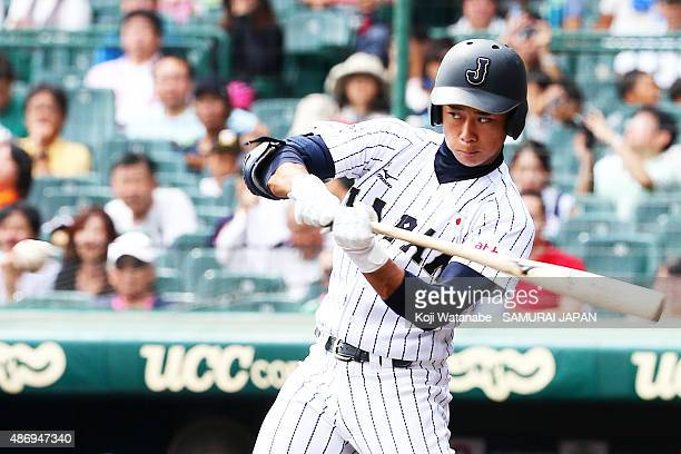 Infielder Taiga Hirasawa hits a RBI single in the bottom half of the third inning in the super round game between Japan v Cuba during the 2015 WBSC...