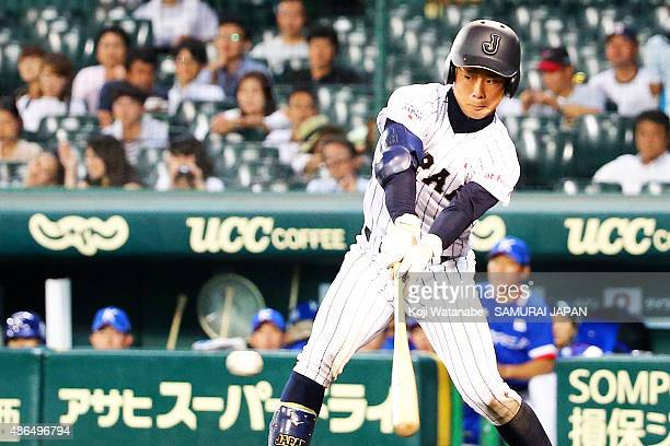 Infielder Taiga Hirasawa of Japan hits a RBI single in the bottom half of the sixth inning the game between Australia and Japan in the super round...