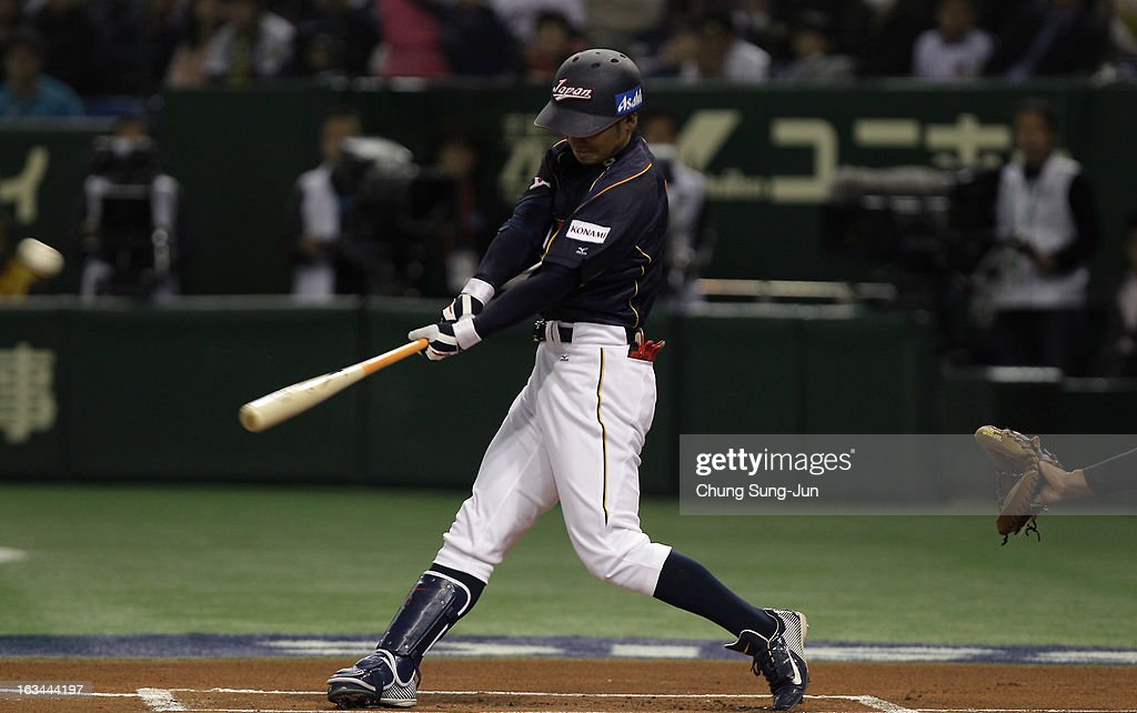 Infielder Takashi Toritani # 1 of Japan hits a solo home run top of the first inning during the World Baseball Classic Second Round Pool 1 game between Japan and the Netherlands at Tokyo Dome on March 10, 2013 in Tokyo, Japan.