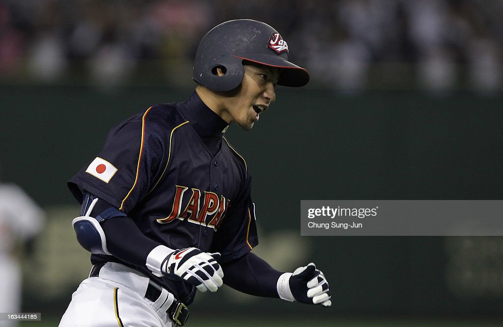 Infielder Takashi Toritani # 1 of Japan reacts after hits a solo home run top of the first inning during the World Baseball Classic Second Round Pool 1 game between Japan and the Netherlands at Tokyo Dome on March 10, 2013 in Tokyo, Japan.