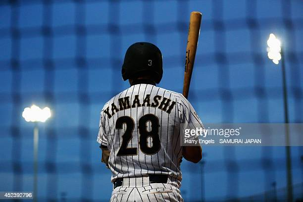 Infielder Tatsuya Yamaashi of Japan warms up before heading out to bat during the Haarlem Baseball Week semi final match between Japan and the...