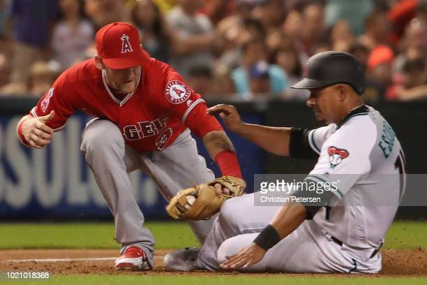 Infielder Taylor Ward of the Los Angeles Angels tags out Eduardo Escobar of the Arizona Diamondbacks as he slides into third base during the third...