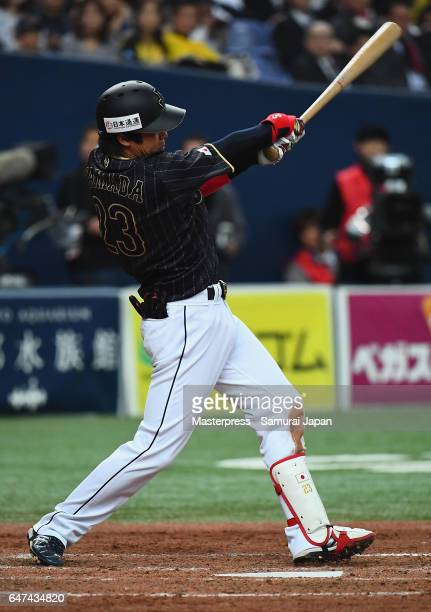 Infielder Tetsuto Yamada of Japan hits a double in the top of the seventh inning during the World Baseball Classic WarmUp Game between Japan and...