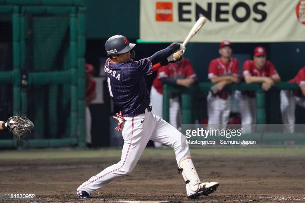 Infielder Tetsuto Yamada of Japan hits a RBI single to make it 2-0 in the top of 5th inning during the game two between Samurai Japan and Canada at...