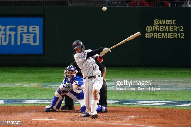 Infielder Tetsuto Yamada of Japan hits a sacrifice fly in the bottom of 3rd inning during the WBSC Premier 12 Super Round game between Japan and...