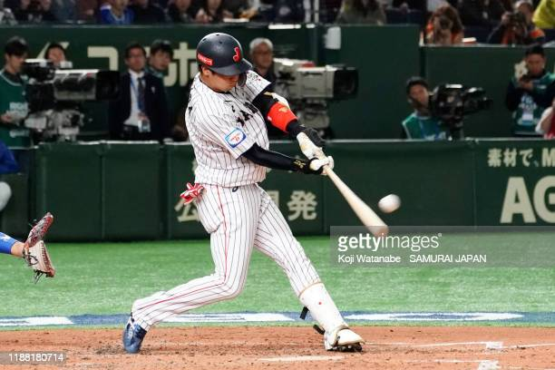 Infielder Tetsuto Yamada of Japan hits a three-run homer to make it 3-4 in the bottom of 2nd inning during the WBSC Premier 12 final game between...