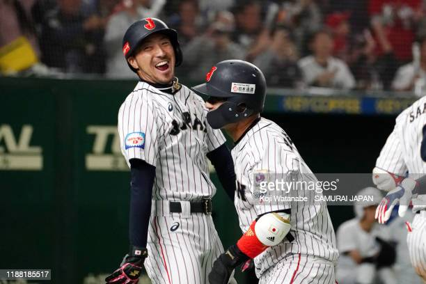 Infielder Tetsuto Yamada of Japan is congratulated by Infielder Ryosuke Kikuchi after hitting a three-run homer to make it 3-4 in the bottom of 2nd...
