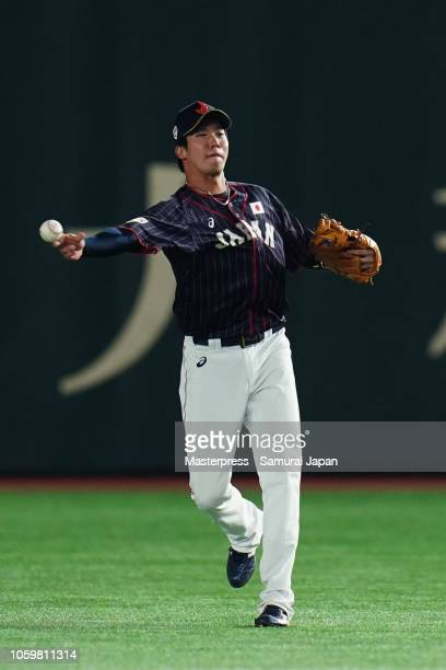 Infielder Tetsuto Yamada of Japan throws after fielding a grounder by Outfielder Enrique Hernandez of the Los Angeles Dodgers in the bottom of 5th...