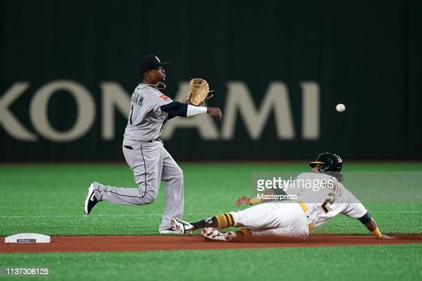 Infielder Tim Beckham of the Seattle Mariners throws to the first base in attempt to make a double play in the 2nd inning during the game between...