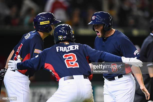Infielder Tyler Pastornicky of the United States celebrates after scoring a run to make 31 by a tworun double with infielder Elliot Soto and Adam...