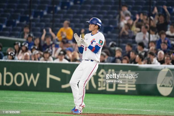 Infielder WeiChen Wang of Team Chinese Taipei hits a RBI singleduring the WBSC Premier 12 Super Round game between Chinese Taipei and Australia at...