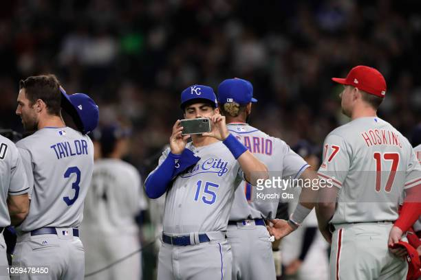 Infielder Whit Merrifield of the Kansas City Royals takes pictures with his mobile prior to the game one of the Japan and MLB All Stars at Tokyo Dome...