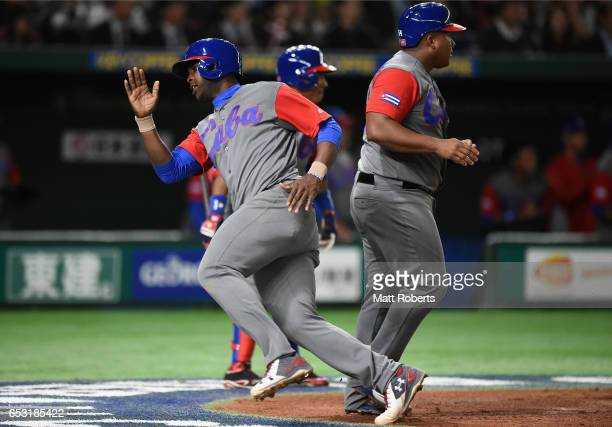 Infielder William Saavedra of Cuba celebrates scoring a run to make it 4-2 by a two run single of Outfielder Victor Mesa during the World Baseball...