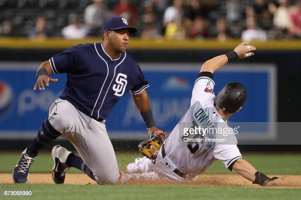 Infielder Yangervis Solarte of the San Diego Padres tags out Chris Owings of the Arizona Diamondbacks as he attempts to steal second base during the...