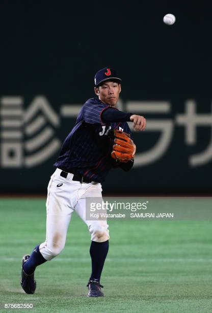 Infielder Yota Kyoda of Japan throws to the first base after fielding a grounder by Infielder Chu YuHsien of Chinese Taipei in the bottom of sixth...