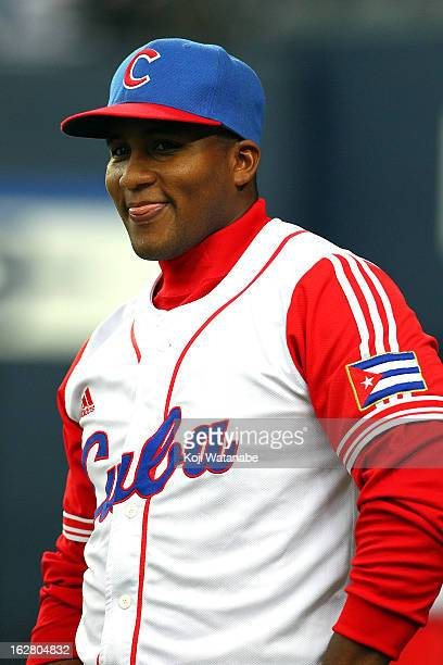 Infielder Yulieski Gourriel of Cuba looks on the friendly game between Hanshin Tigers and Cuba at Kyocera Dome Osaka on February 27 2013 in Osaka...