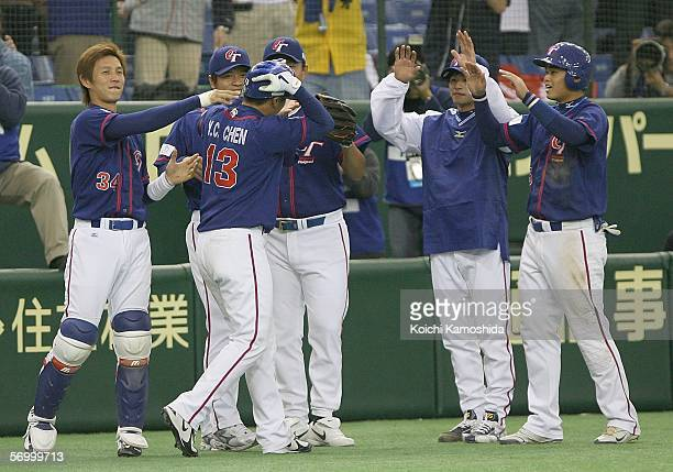 Infielder Yung Chi Chen of Chinese Taipei celebrates his grand slam homer with his team mates during the first round of the 2006 World Baseball...