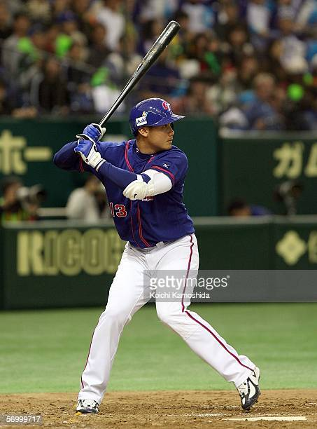 Infielder Yung Chi Chen of Chinese Taipei waits for China pitch during the first round of the 2006 World Baseball Classic at the Tokyo Dome on March...