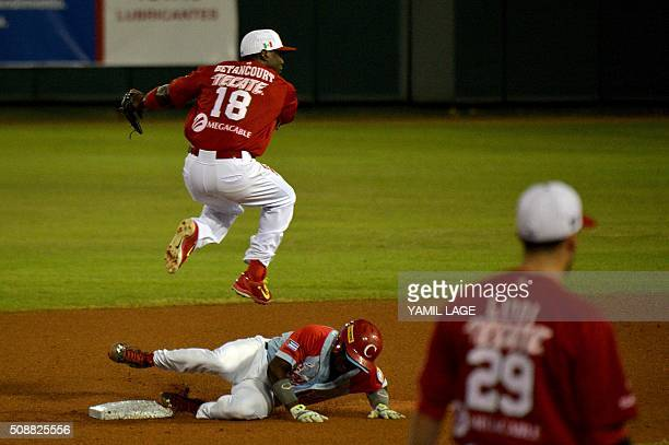 Infielder Yunieski Betancourt at Mexico makes the out on second base against Adolis Garcia at Cuban during their 2016 Caribbean baseball series game...