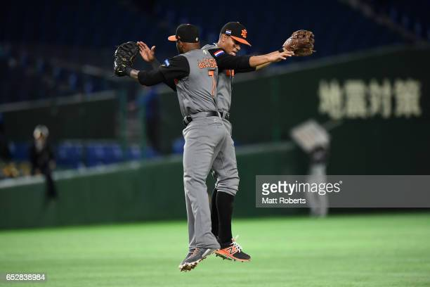 Infielder Yurendell de Caster and Infielder Xander Bogaerts of the Netherlands celebrate their 122 victory in the World Baseball Classic Pool E Game...