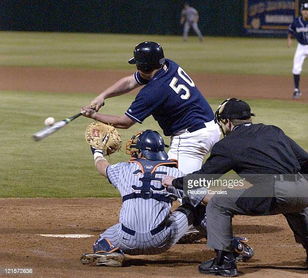 Infielder Zach Robinson of the Univeristy of CaliforniaIrvine Anteaters at the plate hitting versus CalState Fullerton at Anteater Ballpark in Irvine...