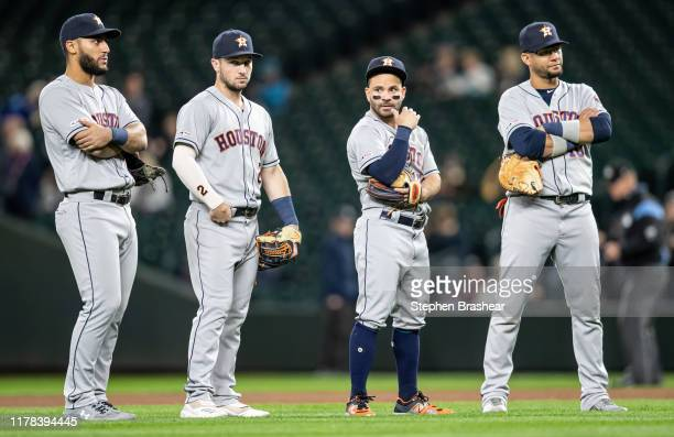 Infielders Abraham Toro of the Houston Astros, Alex Bregman, Jose Altuve and Yuli Gurriel stand on field during a pitching change in a game against...