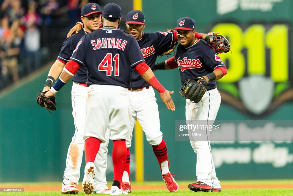 Infielders Carlos Santana #41; Giovanny Urshela #39 Francisco Lindor #12 and Jose Ramirez #11 of the Cleveland Indians celebrate after the Indians defeated the Detroit Tigers at Progressive Field on September 12, 2017 in Cleveland, Ohio. The Indians defeated the Tigers for their 20th straight win.