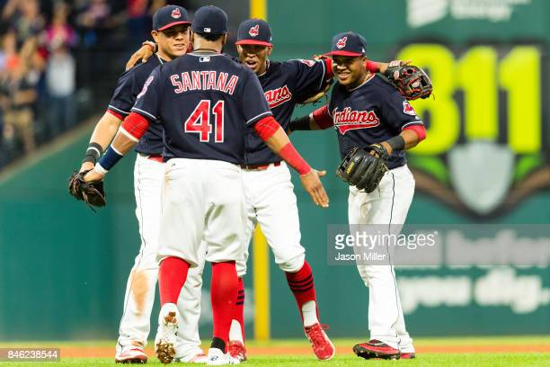 Infielders Carlos Santana Giovanny Urshela Francisco Lindor and Jose Ramirez of the Cleveland Indians celebrate after the Indians defeated the...