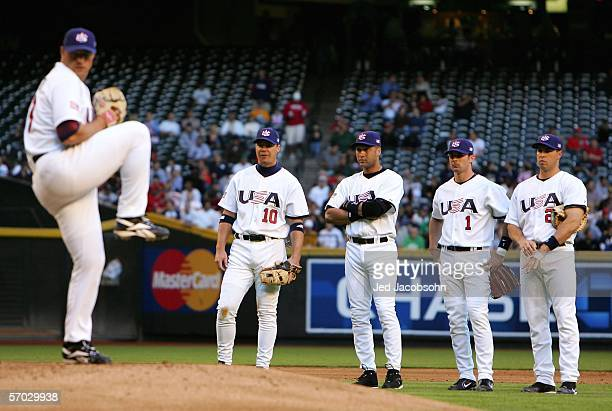 Infielders Chipper Jones Derrek Jeter Michael Young and Mark Teixeira of Team USA look on during a pitching change from the Round 1 Pool B Game of...