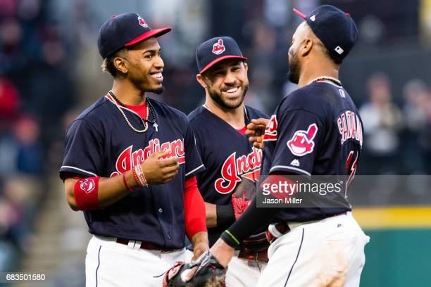 Infielders Francisco Lindor Jason Kipnis and Carlos Santana of the Cleveland Indians joke during a pitching change during the sixth inning against...
