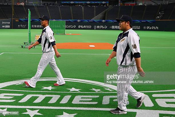 Infielders Sho Nakata and Takeya Nakamura of Japan look on during a warm up prior to the WBSC Premier 12 match between Japan and South Korea at the...