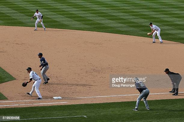 Infielders Trevor Story DJ LeMahieu and Mark Reynolds of the Colorado Rockies play a defensive shift against the San Diego Padres during opening day...