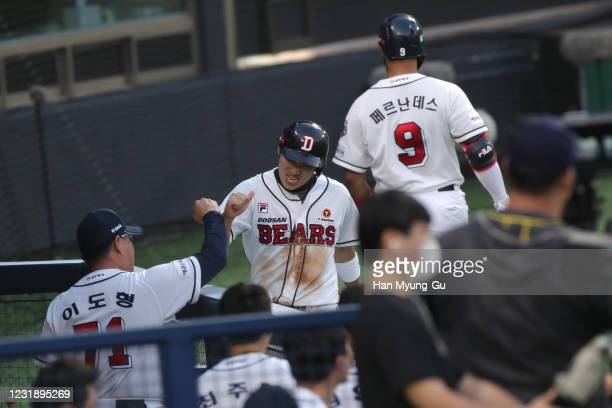 Infilder Heo Kyoung-Min of Doosan Bears high fives with teammates in the bottom of the third inning during the KBO League game between Lotte Giants...