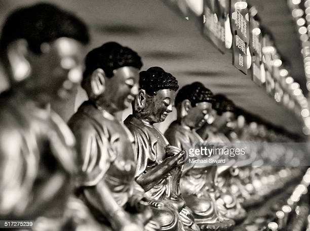 infinite line of buddhas - michael siward stock pictures, royalty-free photos & images