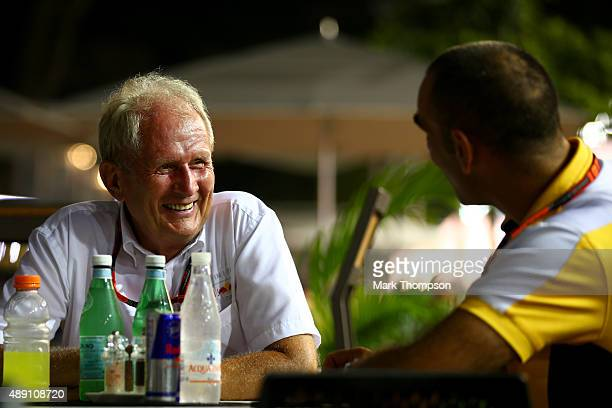 Infiniti Red Bull Racing Team Consultant Dr Helmut Marko speaks with Renault's Cyril Abiteboul in the paddock after qualifying for the Formula One...