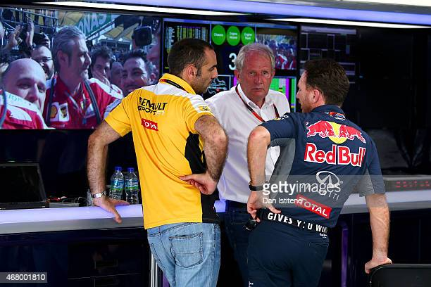 Infiniti Red Bull Racing Team Principal Christian Horner and team consuwltant Dr Helmut Marko speak with Renault's Cyril Abiteboul in the team garage...